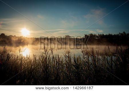 Beautiful Misty Sunrise Over The Lake