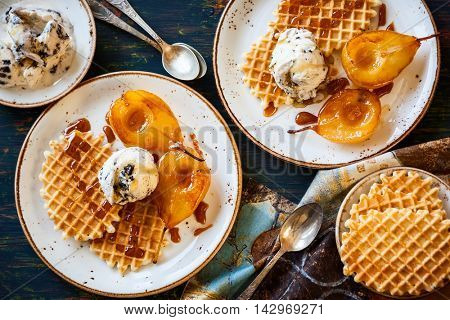 Caramelized pears with waffles, ice-cream and caramel sauce