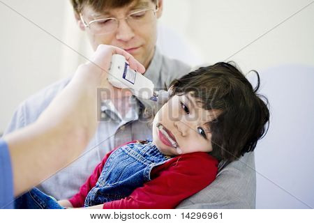 Father holding sick son in the hospital
