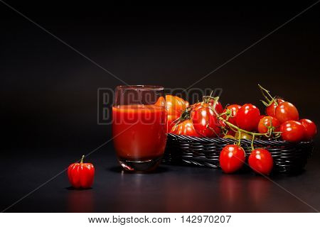 fresh juice, mix vegetable, carrot and tomato drinks with nature black background