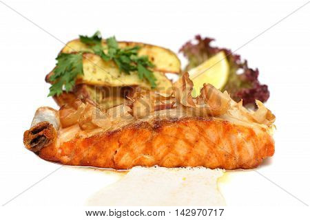 Salmon Steak with garnish gourmet food on white plate