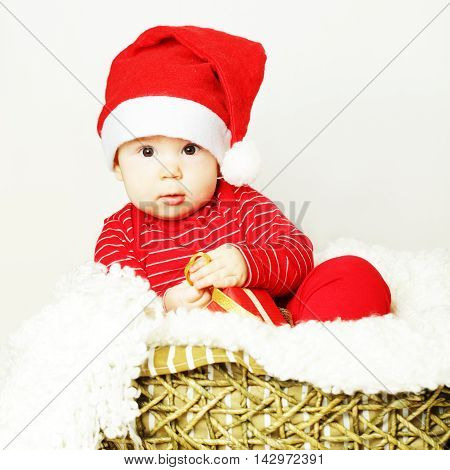 Baby in Santa hat New Year concept