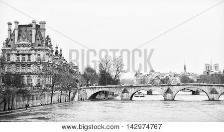 Bridge Pont Royal in central Paris, France. Photo in retro style.