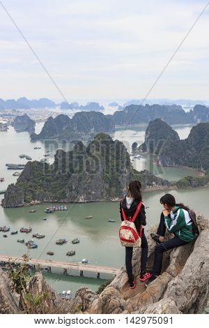 Halong Bay, Vietnam - February 24, 2016: Young Couple Looking At Halong Bay And City From The Top Of