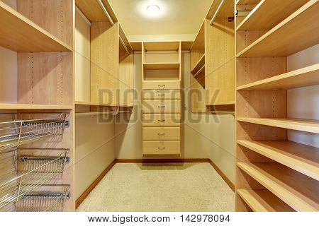 Large Walk In Closet With Hardwood Floor, Also Including Many Shelves