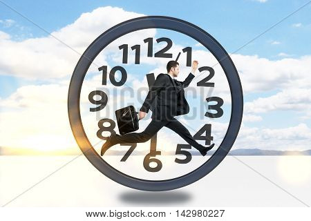 Businessman with briefcase running inside clock on sky background with sunlight. Time management concept