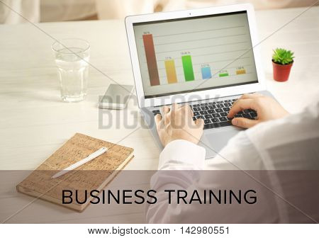 Business training concept. Man using modern laptop at table