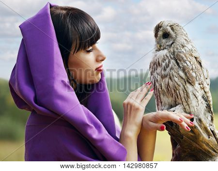 witch in a purple cloak, talking with owl