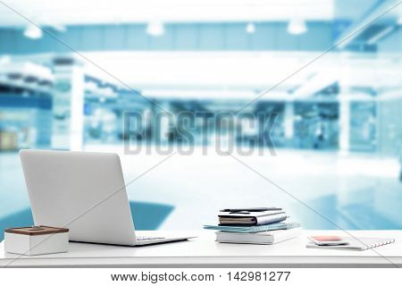 Law concept. Lawyer workplace with laptop on blurred office background.