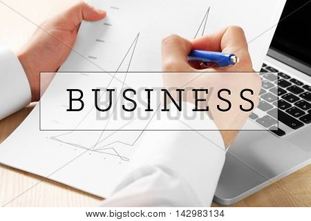 Business training concept. Businessman analyzing charts, closeup
