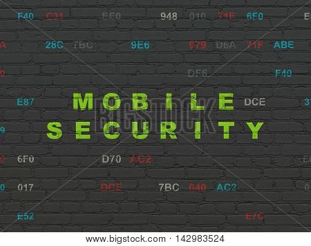 Protection concept: Painted green text Mobile Security on Black Brick wall background with Hexadecimal Code