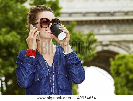 Happy Young Trendy Woman While Drinking Coffee On Champ Elysees