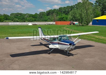 Light private plane on the airfield parked with its doors open