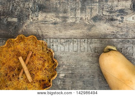 Delicious homemade pumpkin pie on wooden background