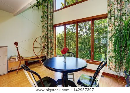 Traditional Dining Area With Adorable Curtains.