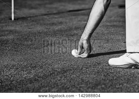 Golfer Placing The Marker