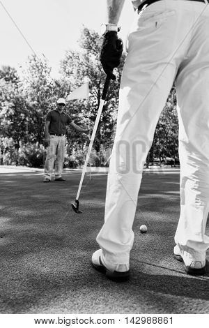 Golfers on green, black and white image