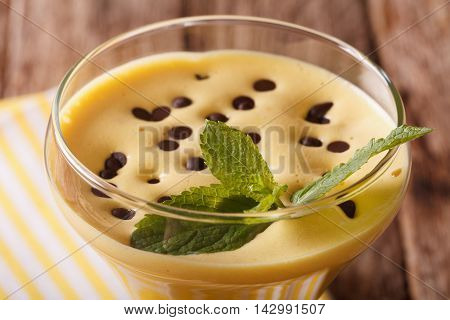 Egg Cream Zabaione With Chocolate Drops And Mint Macro. Horizontal