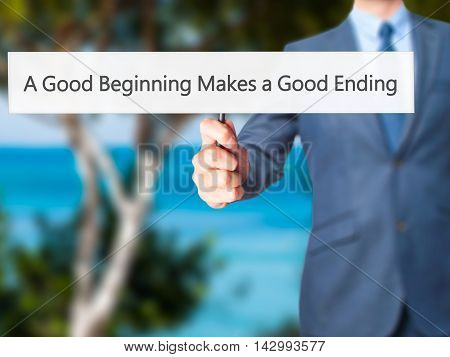A Good Beginning Makes A Good Ending - Business Man Showing Sign