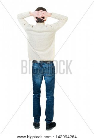 Back view of man . Standing young guy. Rear view people collection.  backside view of person.  Isolated over white background.Curly short-haired guy in a white jacket wool clasped his hands on his