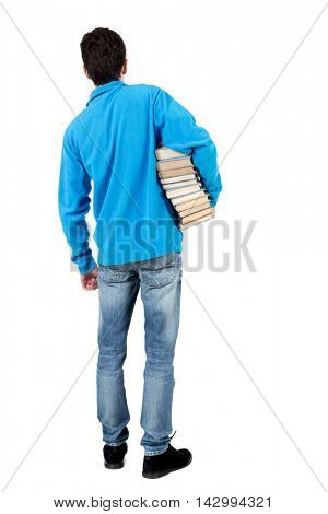 A man carries a heavy pile of books. back view. Rear view people collection.  backside view of person.  Isolated over white background. The curly-haired student in a blue warm jacket standing with a
