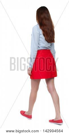 back view of walking  woman. beautiful blonde girl in motion.  backside view of person.  Rear view people collection. Isolated over white background. Long-haired brunette in red skirt is diagonally.