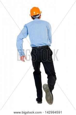 Back view of running engineer in helmet. Walking guy in motion. Rear view people collection. Backside view of person. Isolated over white background. Businessman in a blue shirt and a helmet in a