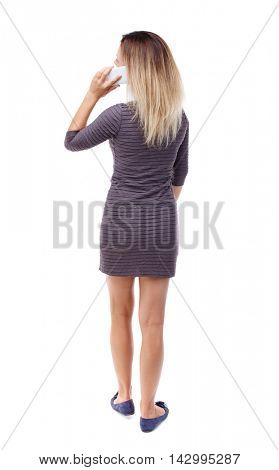 back view of a woman talking on the phone.  backside view of person.  Rear view people collection. Isolated over white background.  Blonde in violet short dress talking on the phone and looking up.