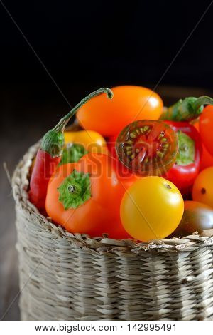 Fresh ripe colorful vegetables tomatoes in basket