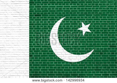 Flag of Pakistan on brick wall texture background. Pakistani national flag. 3D illustration