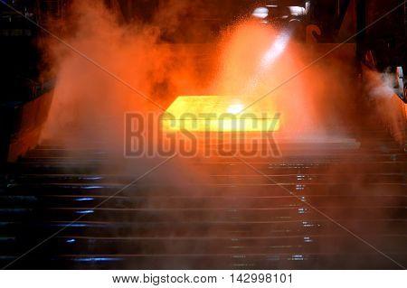 hot steel on conveyor in steel plant