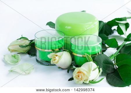 Cosmetic composition of cream bottles with roses