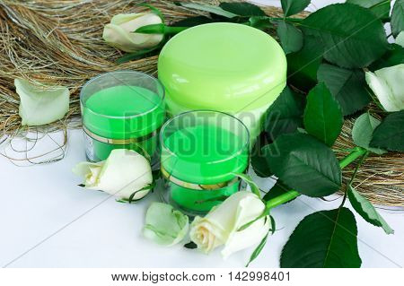 Cosmetic set of cream bottles with roses