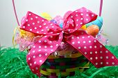 stock photo of poka dot  - A huge pink bow on an Easter basket.