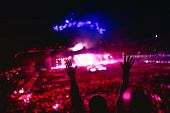 Постер, плакат: Music Concert With Lights And Silhouette Of A Woman Enjoying The Concert Girl Hands At Concert Lov