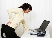 picture of spinal-column  - Woman with back pain of the intervertebral disc in office - JPG