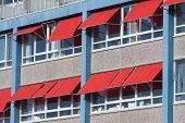 picture of canopy roof  - Facade of a modern building with red sunshades - JPG