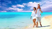 picture of family vacations  - View of happy young family having fun on the beach - JPG