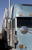 foto of semi-truck  - semi truck tractor chrome detail side view - JPG