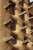 picture of dogon  - A vertical image of the side wall of a Dogon mud mosque - JPG