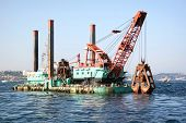 stock photo of dredge  - Floating dredge platform in the Bosporus sea - JPG
