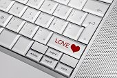 picture of long distance relationship  - Silver keyboard with heart icon and LOVE text on keys - JPG