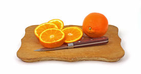 picture of tangelo  - A whole tangelo and fresh juicy slices on cutting board - JPG
