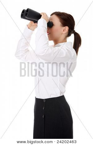 Businesswoman looks through binoculars into the future
