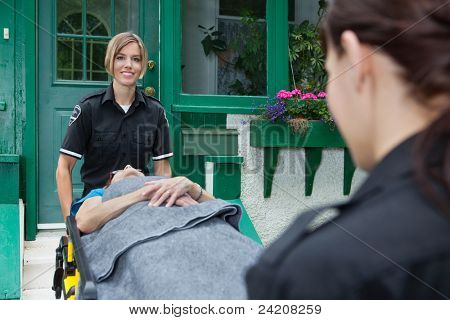 Smiling emergency with patient on stretcher