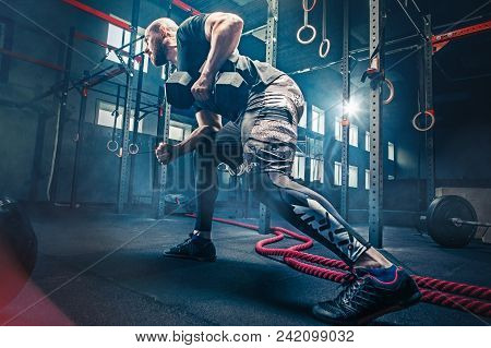 poster of Fit Young Man Lifting Barbells Working Out At A Gym. Sport, Fitness, Weightlifting, Bodybuilding, Tr