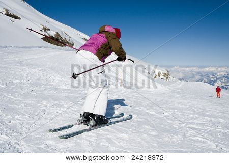 Woman downhill ski in alps on ski slope