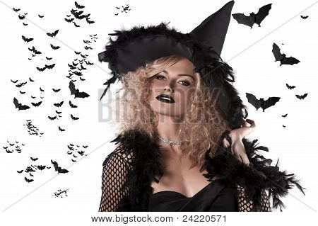 Portrait Of A Curly Blonde Wearing A Huge Witch Hat