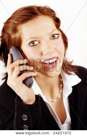 Young business lady surprised of a phone call