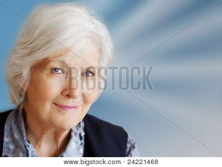 Senior lady portrait on blue with beams